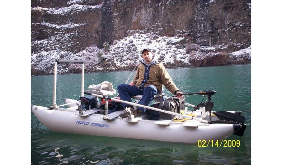 George Davis trolls for Kokanee salmon on Lake Billy Chinook, Oregon, in his Sea Eagle FoldCat