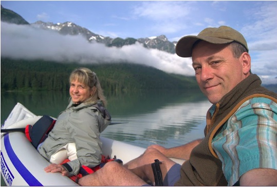 """Out for a paddle on Chilcoot Lake Alaska. The McCanna's own a Sea Eagle 300, 2 person inflatable kayak. It just fits the 50-lb bag rule for airline luggage. """"Always nice to have your own boat to get out on the water!"""""""