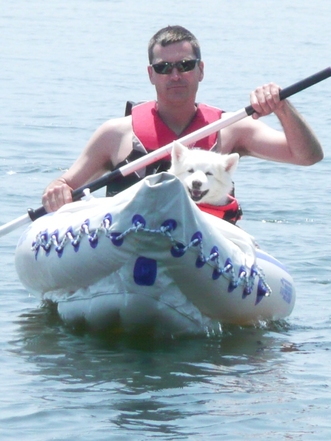 Tim Faulkner paddles his Sea Eagle 330 while Morgan navigates