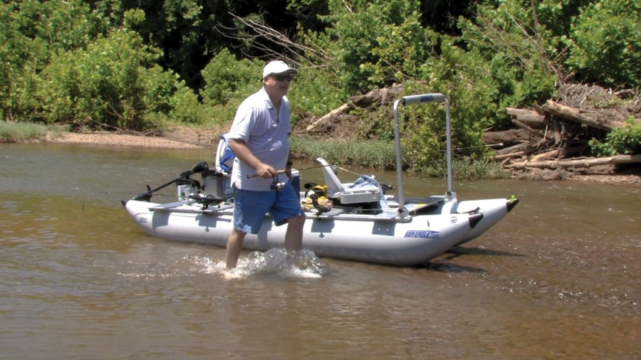"John parks his FoldCat 375fc in the middle of the river. ""Try doing this is a bass boat!"""