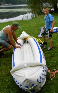 Grandson Vincent's busy inflating the Sea Eagle 370 while Rich checks his work