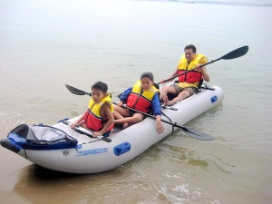 Clarence, Vanessa, and Vincent can often be found in their Sea Eagle PaddleSki in the waters around Singapore
