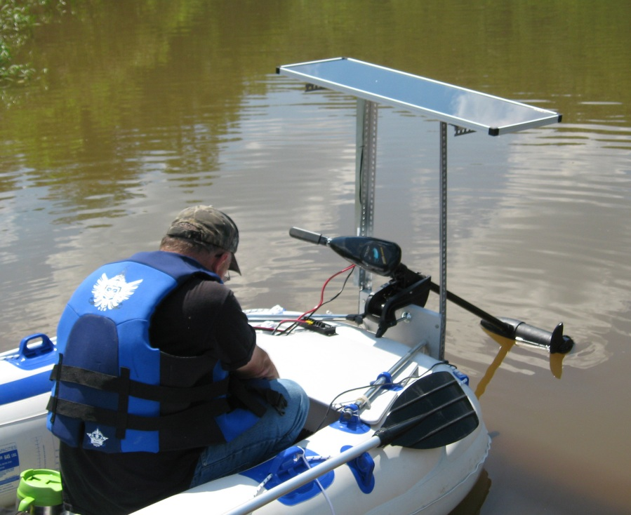 "Homemade SOLAR POWER! ""Hello, Sea Eagle, Here's a picture taken in 2008 of the 15 watt solar panel at Lake O""Brain near Ripley, West Virginia. My brother Michael in the boat getting the system ready to run. We ran the electric trolling motor all day and had a great time fishing. After we got back to his place we tested the battery; it had 70% charge left. I like Sea Eagle's new 45 watt solar panel. I am an electrician and i think Sea Eagle has a great set up with their solar system. Sure beats buying gas! Thanks, Raymond!"""