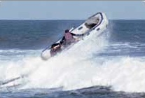 "Sea Eagle VP, John Hoge, goes airborne in a Sea Eagle Sport Runabout, the ""Sports Cars of the Sea."""