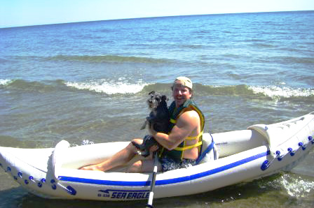 David Anderson and his miniature schnauzer, Jack, in his Sea Eagle 330 sport kayak