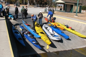 Phyllis and friends ready their kayaks for water adventure