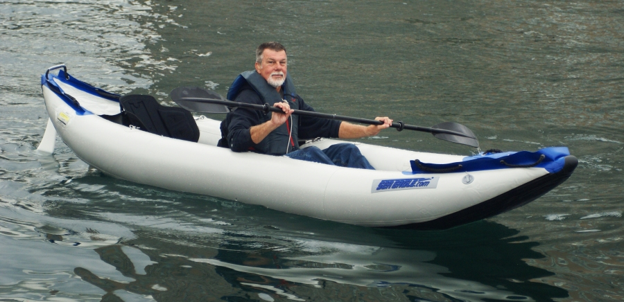 "While living in the Bahamas, and living full time aboard Boatel I, the Greenes use their Sea Eagle Adventure Kayak as their ""car"" to go from boat to shore and back again."