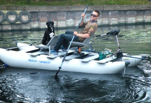 """Here's Wayne's youngest son, Michael, out for a spin in Dad's FoldCat. His loyal but furry companion is named Jack. Wayne says, """"Jack will sit on that seat all day long. I'll go out in the FoldCat if Jack will let me have a seat."""""""
