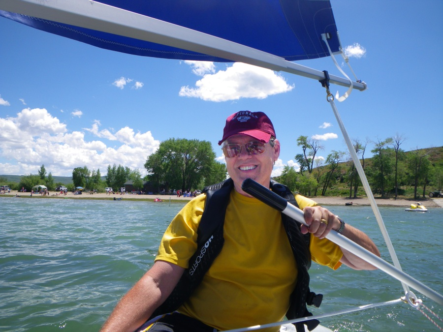 Jim takes the helm on a beautiful day in their Sea Eagle FoldCat