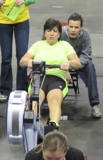 "Rose got hooked on rowing during her rehabilitation from a torn rotator cuff. Here she's in competition in Boston. ""Okay, encouragement is over...I'm about 1700 meters into it and Jane is now ordering me to do another power 10. I give a slight shake of my head and she responds...""Don't you shake you head at me....GIVE ME A POWER 10!"""