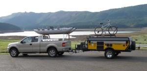 "George is ready for just about any outdoor adventure in what he calls his ""Pacific Northwest Weekend Package."" He carries his FoldCat on his truck rack and tows a popup camper with his mountain bike on top. Oregon's Fall Creek Lake, Willamette National Forest in the background."