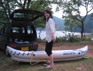 """My Japanese friend, Yuko, pumps up my Sea Eagle 330, We are about to launch on Lake Manahime in Fukui Prefecture, Japan. At first Yuko didn't seem to appreciate the untouched beauty of the lakes, but after several trips together she finally confessed, ""OK Sam-san – this lake is beautiful after all."""