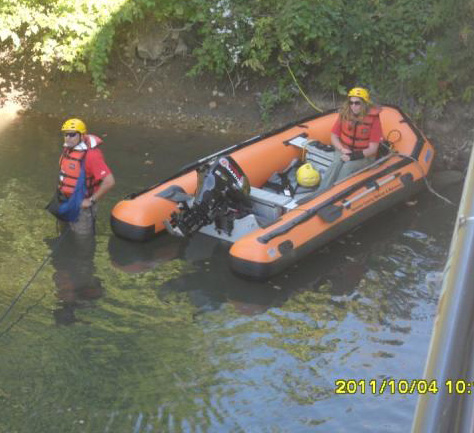 Hurricanes come only once in awhile but this rescue team is ready for anything. Here, two members search for forensic evidence thrown off a bridge.