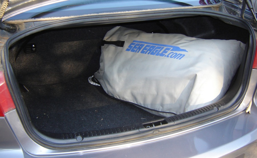 No roof rack or trailering. The deflated 330, plus seats and oars, fits in a single bag. And the bag fits in a compact car trunk with plenty of room to spare.