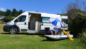 Ken catches up on some rest and relaxation beside his compact campervan. The inflatable FastTrack is a perfect boat for RV'ing -- it rolls up tight and packs in a small bag.