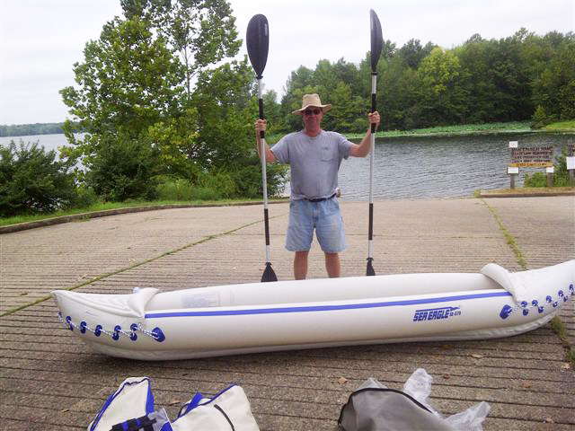 Mark Venard poses as he prepares for a day's outing in their Sea Eagle 370.