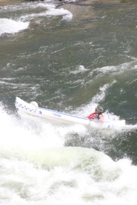 Henry Michael roars through Class III rapids in Idaho's Payette River in his Sea Eagle 370.