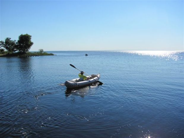 "Linda paddles out into Whitefish Bay in Lake Superior on a recent tent camping vacation. ""Best vacation I ever had,"" she says."