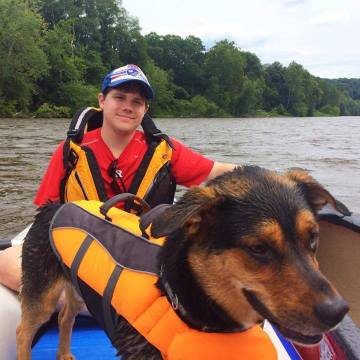 Bobby and his loyal canine boating buddy, Dexter, share a trip down the mighty Delaware in Bobby's Sea Eagle.